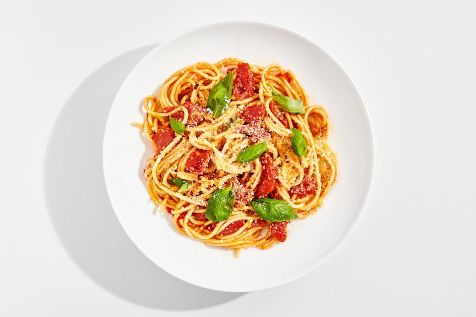 """Nothing says """"baby's first kitchen"""" quite like mediocre store-bought marinara sauce dumped over clumpy noodles—but nothing says """"hello I am a confident, resourceful, worldly home cook"""" like a tangle of perfectly-cooked spaghetti cradling a rich, buttery, almost-as-easy-to-make-as-opening-a-can pomodoro sauce. And once you've made this recipe, you'll understand all of the tricks and techniques that separate mediocre at-home pasta dishes from the ones fancy restaurants charge the big bucks for. This recipe is a part of the <a rel=""""nofollow noopener"""" href=""""https://www.bonappetit.com/collection/basically-10x10?mbid=synd_yahoo_rss"""" target=""""_blank"""" data-ylk=""""slk:Basically 10x10"""" class=""""link rapid-noclick-resp"""">Basically 10x10</a>, a collection of ten essential, no-fail recipes that every home cook should have in their arsenal. <a rel=""""nofollow noopener"""" href=""""https://www.bonappetit.com/recipe/basically-spaghetti-pomodoro?mbid=synd_yahoo_rss"""" target=""""_blank"""" data-ylk=""""slk:See recipe."""" class=""""link rapid-noclick-resp"""">See recipe.</a>"""