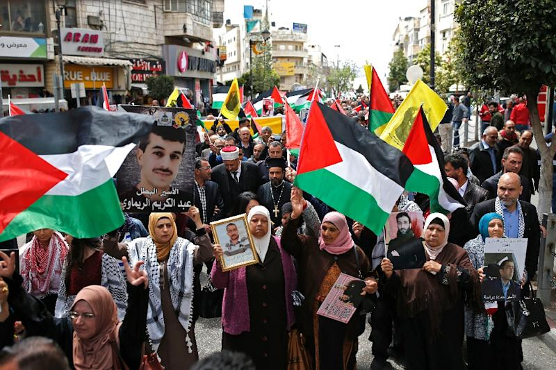 The Palestinians regard their prisoners in Israeli jails as national heroes, the source of a major row with Israel's right-wing government that has triggered a crisis in their finances (AFP Photo/ABBAS MOMANI)