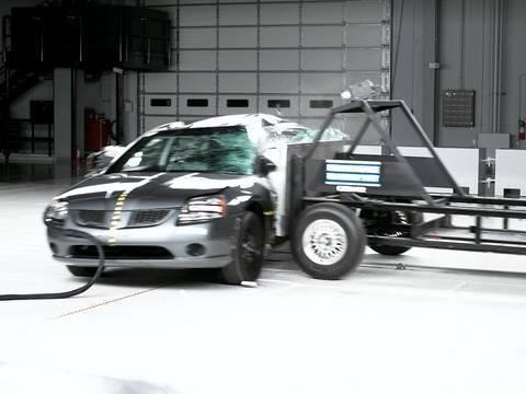 """<p>The 2004 Mitsubishi Galant debuted as a wider, longer, and larger sedan than any Galant before it. Its new platform, dubbed Project America, would also underpin the Eclipse coupe and Endeavor SUV. During IIHS crash testing, the Galant received a Good rating for front moderate overlap, but Poor ratings for both side and head restraints and seats. The rig that's sent directly into the driver's side of cars at 31-mph in this test weighs as much as a fully loaded Ford EcoSport, or roughly 3300 pounds. Compare that to the 4400-pound heft of your average midsize truck or SUV sold in America, and the results would only be worse in the real world. For the Galant, the driver's head made contact with the rig, leaving a visible dent in its sheet metal. That's a definite fail. Mitsubishi made side-curtain airbags standard on the Galant for 2005, which helped prevent head impact, and improved safety ratings. The Galant was discontinued after the 2012 model year.</p><p><a href=""""https://www.youtube.com/watch?v=ZqEBXt_9UxU&t=6s"""" rel=""""nofollow noopener"""" target=""""_blank"""" data-ylk=""""slk:See the original post on Youtube"""" class=""""link rapid-noclick-resp"""">See the original post on Youtube</a></p>"""