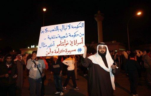 A protestor holds an anti-government placard at a demonstration in Kuwait City on January 6, 2012. The opposition has been staging regular demonstrations in protest at an amendment of the electoral law and the subsequent holding of December's parliamentary vote on the basis of the amended legislation