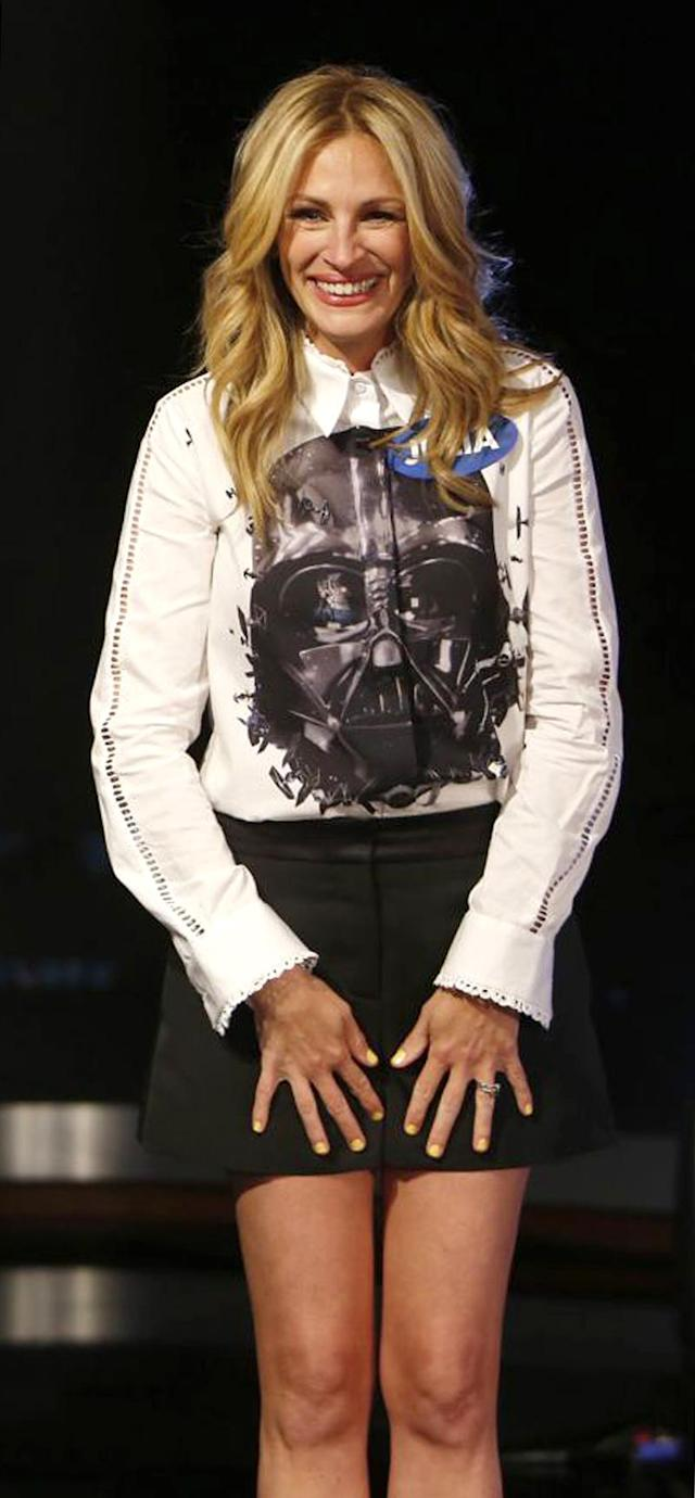 "<p>After the <em>Pretty Woman</em> star appeared on both <em>Jimmy Kimmel Live!</em> (shown here) and <em>HuffPost Live</em> sporting the face of villainous Darth Vader within days, a reporter just had to ask her about it. ""I have three children, two of them are boys, and <a href=""http://www.huffingtonpost.com/2014/05/13/julia-roberts-star-wars-dress_n_5317339.html"" rel=""nofollow noopener"" target=""_blank"" data-ylk=""slk:they are Star Wars fans"" class=""link rapid-noclick-resp"">they are <em>Star Wars</em> fans</a>,"" she explained. (Photo: Getty Images) </p>"