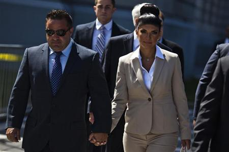 """Teresa Giudice and her husband Giuseppe """"Joe"""" Giudice hold hands as they leave the federal court in Newark, New Jersey"""