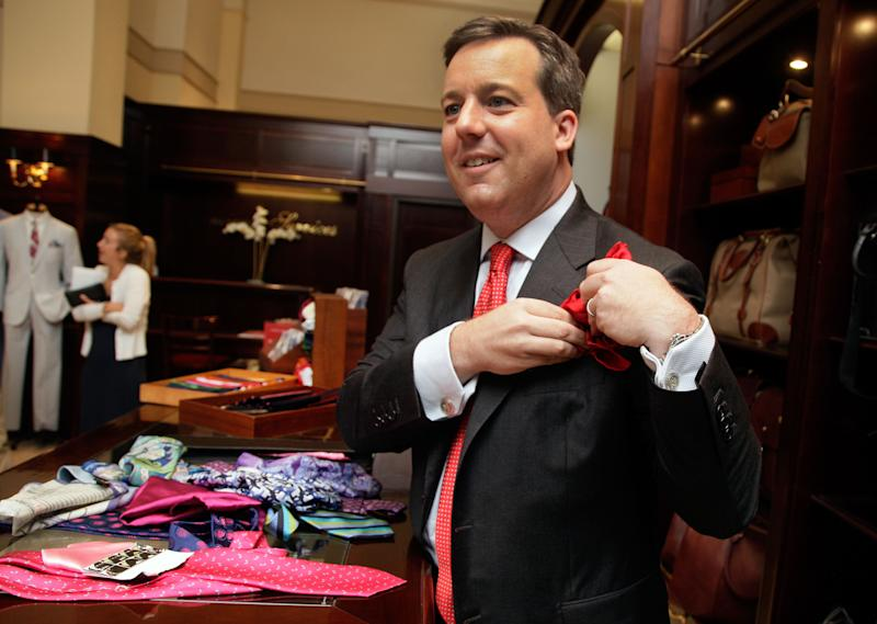 This June 18, 2012 photo shows Ed Henry, chief White House correspondent on the Fox News Channel, adjusts his pocket square at the Brooks Brothers flagship store in New York.  Henry's pocket square flair all started as a friendly fashion competition with a former colleague. It was all about the bigger, better necktie back then, Henry says. There was an unending game of one-upmanship with more colorful shirts, perhaps even a pattered vest. Going around the globe, Henry says he picks up ties and pocket squares as souvenirs, and they act as a bit of a travelogue. (AP Photo/Richard Drew)