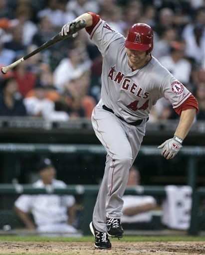 Los Angeles Angels' Mark Trumbo throws down his bat as he flies out in the seventh inning of a baseball game against the Detroit Tigers on Wednesday, July 18, 2012, in Detroit. The Tigers defeated the Angels 7-2. (AP Photo/Duane Burleson)