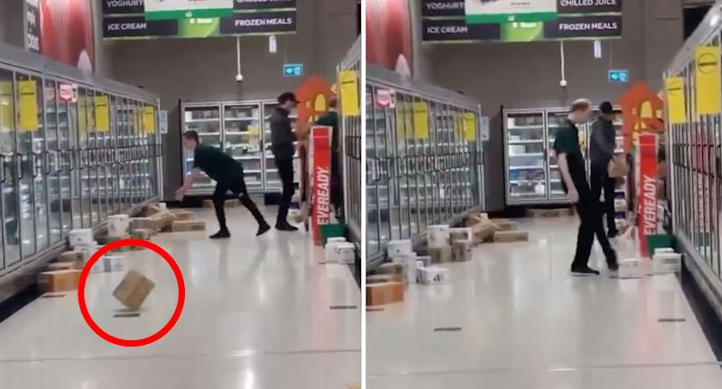 One male worker in the Banyo store throws a box down the aisle, while another (right) kicks a box towards a freezer.