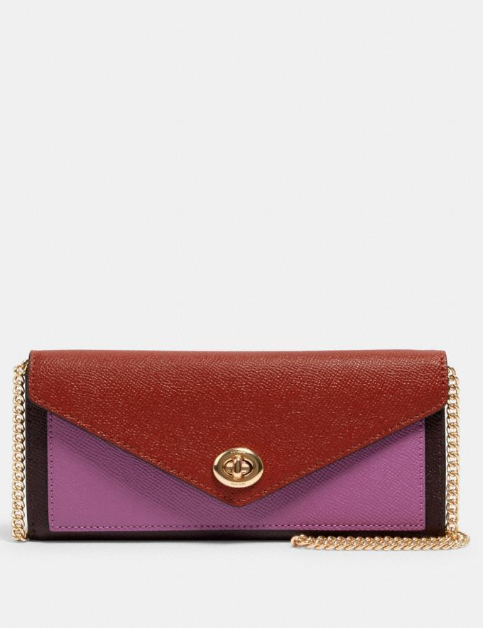 Slim Envelope Wallet With Chain In Colorblock is on sale now through Coach Outlet, $83 (originally $278).