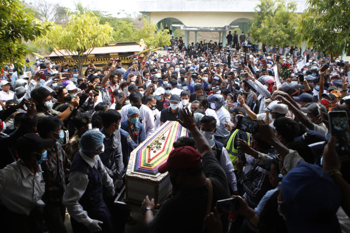 The casket containing the body of Mya Thwet Thwet Khine is carried through the crowds towards the cemetery in Naypyitaw, Myanmar, Sunday, Feb. 21, 2021. Mya Thwet Thwet Khine was the first confirmed death among the many thousands who have taken to the streets to protest the Feb. 1 coup that toppled the elected government of Aung San Suu Kyi. (AP Photo)