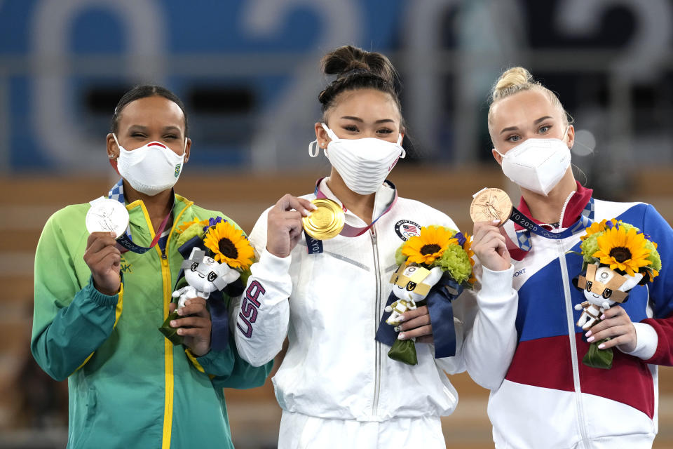 From left: Silver medalist Brazil's Rebeca Andrade, Gold medalist Sunisa Lee of the U.S., and bronze medalist Angelina Melnikova, of the Russian Olympic Committee, celebrate during the medal ceremony for the artistic gymnastics women's all-around at the 2020 Summer Olympics, on July 29, 2021, in Tokyo. (AP Photo/Gregory Bull) - Credit: AP