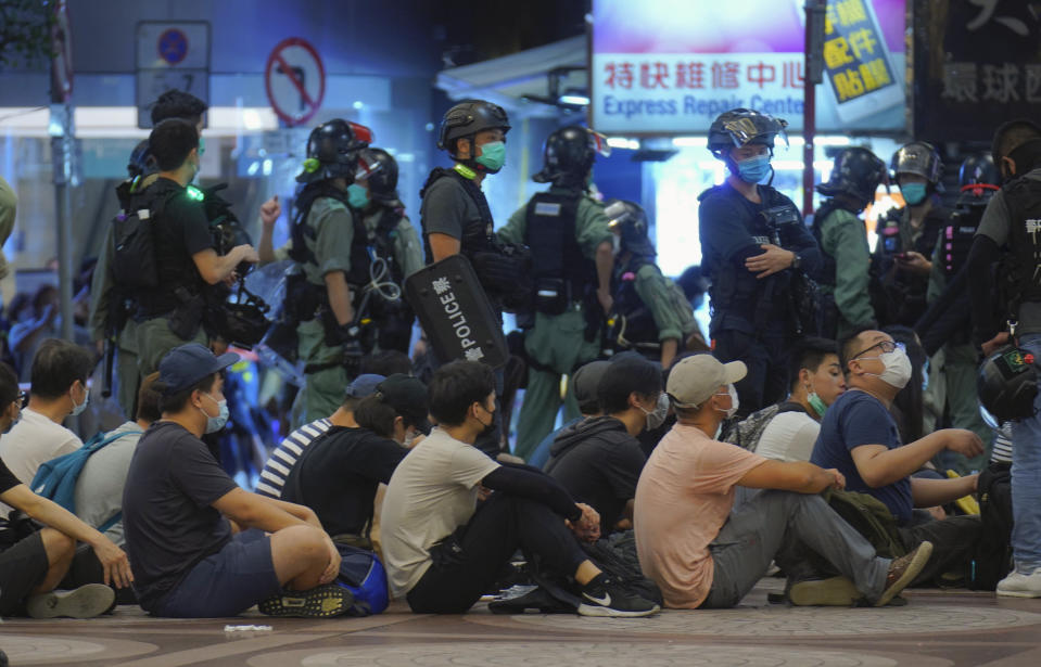 Police detain protesters during a march marking the anniversary of the Hong Kong handover from Britain to China, Wednesday, July. 1, 2020, in Hong Kong. Hong Kong marked the 23rd anniversary of its handover to China in 1997, and just one day after China enacted a national security law that cracks down on protests in the territory. (AP Photo/Vincent Yu)