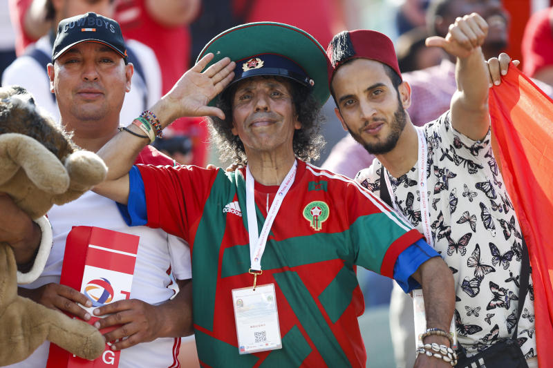 Morocco fans cheer before the African Cup of Nations group D soccer match between Morocco and Namibia in Al Salam Stadium in Cairo, Egypt, Sunday, June 23, 2019. (AP Photo/Ariel Schalit)