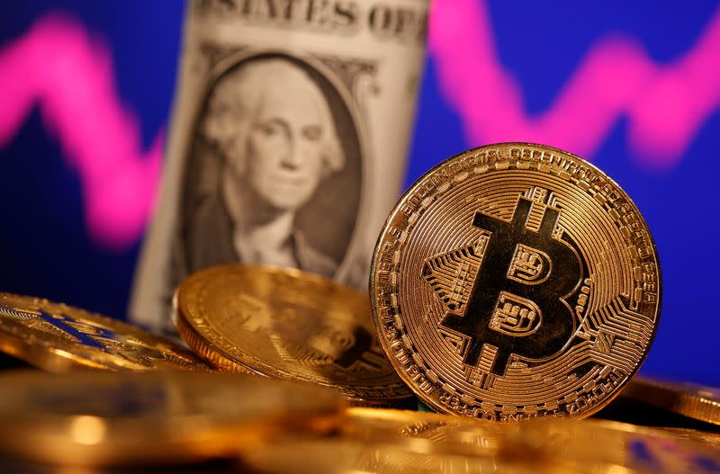 A representation of virtual currency Bitcoin and U.S. One Dollar banknote are seen in front of a stock graph in this illustration