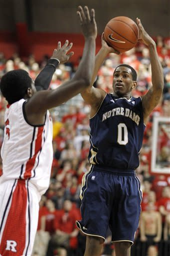 Notre Dame's Eric Atkins, right, shoots against Rutgers' Eli Carter during the first half of an NCAA college basketball game, Monday, Jan. 16, 2012, in Piscataway, N.J. (AP Photo/Julio Cortez)