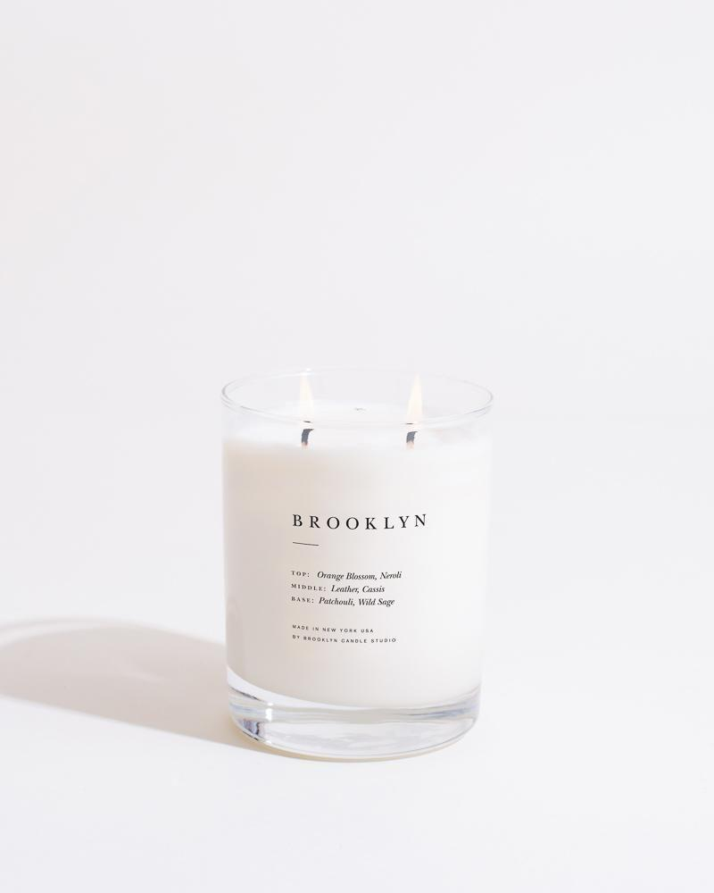 """<p><strong>Brooklyn Candle Studio</strong></p><p>brooklyncandlestudio.com</p><p><strong>$38.00</strong></p><p><a href=""""https://go.redirectingat.com?id=74968X1596630&url=https%3A%2F%2Fbrooklyncandlestudio.com%2Fproducts%2Fbrooklyn-escapist-candle%3Fvariant%3D19692378423399%26currency%3DUSD%26gclid%3DCj0KCQjwlMaGBhD3ARIsAPvWd6j3-wgzpBov4g9R2CejYP5rl3BoHtXc2kxG-N3QFexNnvtbmSQF4PoaAsVWEALw_wcB&sref=https%3A%2F%2Fwww.cosmopolitan.com%2Flifestyle%2Fg32798945%2Fbest-organic-natural-candles%2F"""" rel=""""nofollow noopener"""" target=""""_blank"""" data-ylk=""""slk:Shop Now"""" class=""""link rapid-noclick-resp"""">Shop Now</a></p><p>Ya gotta love Brooklyn! Bring the borough to your humble abode with this gorgeous candle that's made of 100 percent soy wax and has notes like wild sage, cassis, and orange blossom.</p>"""
