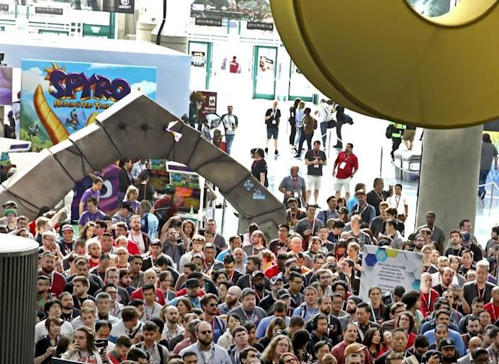 "E3 fans line up near the ""Spyro Reignited Trilogy"" booth, ready to get their game on at the Los Angeles Convention Center on Wednesday, June 13, 2018 in Los Angeles. (Photo by Colin Young-Wolff/Invision for Activision/AP Images)"