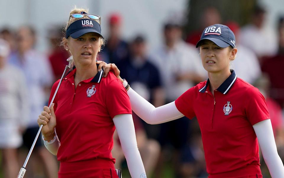 United States' Jessica Korda and Nelly Korda walk off the green after their loss during the foursome matches - AP