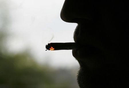 A man smokes a cigarette outside his factory in Bordeaux