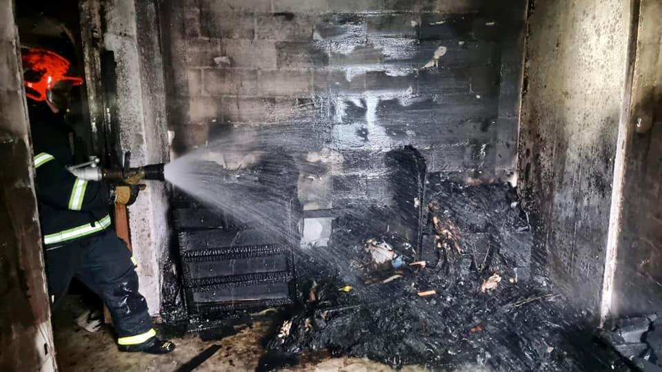 The scene of a fire in the master bedroom of a fourth-level unit at Block 141 Yishun Ring Road on the morning of 29 June, 2021. (PHOTO: SCDF)