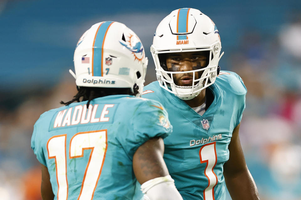 MIAMI GARDENS, FLORIDA - AUGUST 21: Tua Tagovailoa #1 and Jaylen Waddle #17 of the Miami Dolphins converse against the Atlanta Falcons during a preseason game at Hard Rock Stadium on August 21, 2021 in Miami Gardens, Florida. (Photo by Michael Reaves/Getty Images)