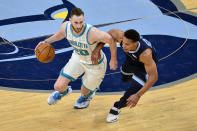 Charlotte Hornets forward Gordon Hayward (20) handles the ball against Memphis Grizzlies guard Desmond Bane (22) in the second half of an NBA basketball game Wednesday, Feb. 10, 2021, in Memphis, Tenn. (AP Photo/Brandon Dill)