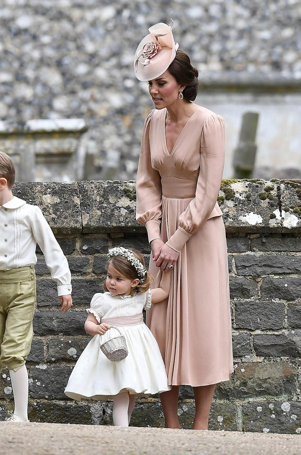 """<p><strong>When:</strong> May 20, 2017 <strong>Where:</strong> Sister <a href=""""http://people.com/royals/how-to-get-pippa-middletons-stylish-and-sometimes-sporty-wardrobe"""" rel=""""nofollow noopener"""" target=""""_blank"""" data-ylk=""""slk:Pippa Middleton"""" class=""""link rapid-noclick-resp"""">Pippa Middleton</a>'s wedding at St. Mark's Church in Englefield, England <strong>Wearing:</strong> Alexander McQueen <strong>Get the Look:</strong> Eliza J Bow-Detail Dress, $138; <a href=""""https://click.linksynergy.com/fs-bin/click?id=93xLBvPhAeE&subid=0&offerid=390098.1&type=10&tmpid=8157&RD_PARM1=https%253A%252F%252Fshop.nordstrom.com%252Fs%252Feliza-j-bell-sleeve-sheath-dress-regular-petite%252F4855761%253Fcontextualcategoryid%253D2375500%2526origin%253Dkeywordsearch%2526keyword%253DBell%252BSleeve%252BSheath%252BDress%2526top%253D72%2526color%253D%252527Pink%252527&u1=POROYALSKateSpringStyleMM"""" rel=""""nofollow noopener"""" target=""""_blank"""" data-ylk=""""slk:nordstrom.com"""" class=""""link rapid-noclick-resp"""">nordstrom.com</a> Calvin Klein Bell-Sleeve Sheath Dress, $90; <a href=""""https://click.linksynergy.com/fs-bin/click?id=93xLBvPhAeE&subid=0&offerid=486467.1&type=10&tmpid=1513&RD_PARM1=https%3A%2F%2Fwww.macys.com%2Fshop%2Fproduct%2Fcalvin-klein-bell-sleeve-sheath-dress%3FID%3D4382498%2526CategoryID%3D5449%2526swatchColor%3DBlush&u1=POROYALSKateSpringStyleMM"""" rel=""""nofollow noopener"""" target=""""_blank"""" data-ylk=""""slk:macys.com"""" class=""""link rapid-noclick-resp"""">macys.com</a></p>"""