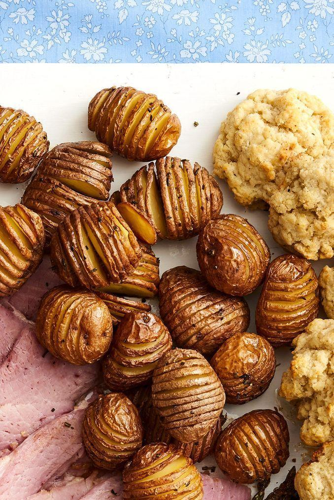 """<p>Jazz up your potatoes with this easy Hasselback dish. All you need for flavoring is salt, pepper, and some rosemary.</p><p><a href=""""https://www.thepioneerwoman.com/food-cooking/recipes/a35567458/rosemary-hasselback-potatoes-recipe/"""" rel=""""nofollow noopener"""" target=""""_blank"""" data-ylk=""""slk:Get the recipe."""" class=""""link rapid-noclick-resp""""><strong>Get the recipe.</strong></a></p><p><a class=""""link rapid-noclick-resp"""" href=""""https://go.redirectingat.com?id=74968X1596630&url=https%3A%2F%2Fwww.walmart.com%2Fsearch%2F%3Fquery%3Dpioneer%2Bwoman%2Bbakeware&sref=https%3A%2F%2Fwww.thepioneerwoman.com%2Ffood-cooking%2Fmeals-menus%2Fg35585877%2Feaster-recipes%2F"""" rel=""""nofollow noopener"""" target=""""_blank"""" data-ylk=""""slk:SHOP BAKEWARE"""">SHOP BAKEWARE</a></p>"""