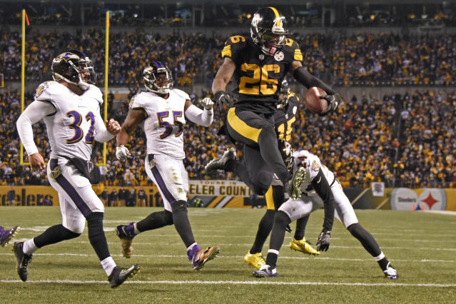 FILE - In this Dec. 25, 2016, file photo, Pittsburgh Steelers running back Le'Veon Bell (26) leaps into the end zone ahead of Baltimore Ravens strong safety Eric Weddle (32) for a touchdown during the second half of an NFL football game in Pittsburgh. The Steelers have put the franchise tag on All-Pro running back LeVeon Bell for a second straight spring, putting his long-term status with the club up in the air. (AP Photo/Don Wright, File)