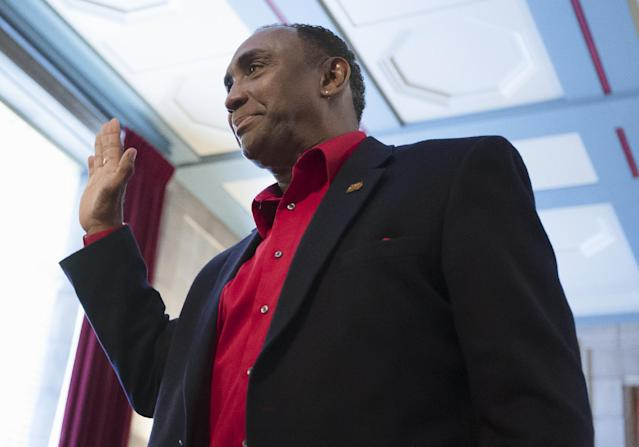 Johnny Rodgers, the 1972 Heisman Trophy winner, swears in at a state Board of Pardons hearing in Lincoln, Neb., Thursday, Nov. 14, 2013. Forty-three years after he and two other men held up a gas station following a night of drinking, Rodgers was granted a pardon from the state of Nebraska. (AP Photo/Nati Harnik)
