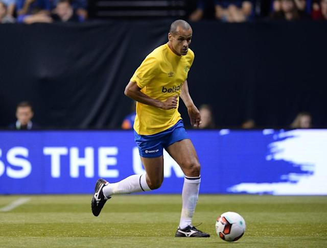 "Brazil's Rivaldo, pictured in 2017, said that ""to become the best in the world"" his compatriot Neymar should leave for Spain (AFP Photo/OLLY GREENWOOD)"
