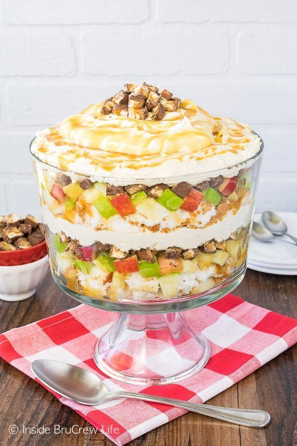 """<p>With layers of crisp apples, creamy cheesecake, and Snickers bars, what's <em>not</em> to love about this dessert?!</p><p><strong>Get the recipe at <a href=""""https://insidebrucrewlife.com/apple-snickers-cheesecake-trifle/"""" rel=""""nofollow noopener"""" target=""""_blank"""" data-ylk=""""slk:Inside BruCrew Life"""" class=""""link rapid-noclick-resp"""">Inside BruCrew Life</a>.</strong></p><p><strong><strong><a class=""""link rapid-noclick-resp"""" href=""""https://www.amazon.com/Anchor-Hocking-Monaco-Trifle-Bowl/dp/B0002YSLXC?tag=syn-yahoo-20&ascsubtag=%5Bartid%7C10050.g.2721%5Bsrc%7Cyahoo-us"""" rel=""""nofollow noopener"""" target=""""_blank"""" data-ylk=""""slk:SHOP TRIFLE BOWLS"""">SHOP TRIFLE BOWLS</a></strong><br></strong></p>"""