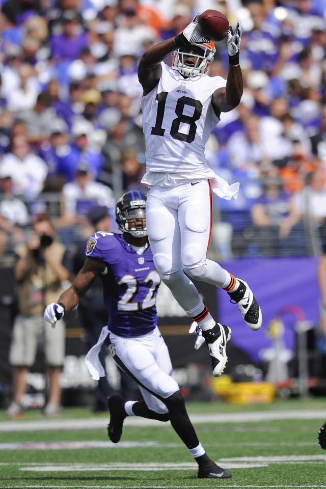 Cleveland Browns wide receiver Greg Little (18) pulls in a pass as Baltimore Ravens cornerback Jimmy Smith (22) closes in during the first half of an NFL football game in Baltimore, Md., Sunday, Sept. 15, 2013. (AP Photo/Nick Wass)
