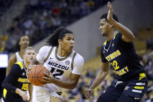 Missouri's Dru Smith (12) heads to the basket as Northern Kentucky's Dantez Walton (32) defends during the second half of an NCAA college basketball game Friday, Nov. 8, 2019, in Columbia, Mo. Missouri won 71-56. (AP Photo/Jeff Roberson)