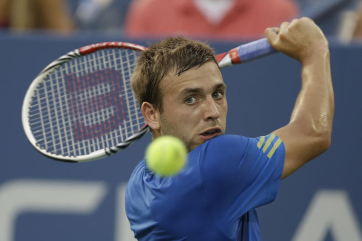 Daniel Evans, of Great Britain, returns a shot to Spain's Tommy Robredo during a third round match at the U.S. Open tennis tournament Saturday, Aug. 31, 2013, in New York. (AP Photo/Darron Cummings)