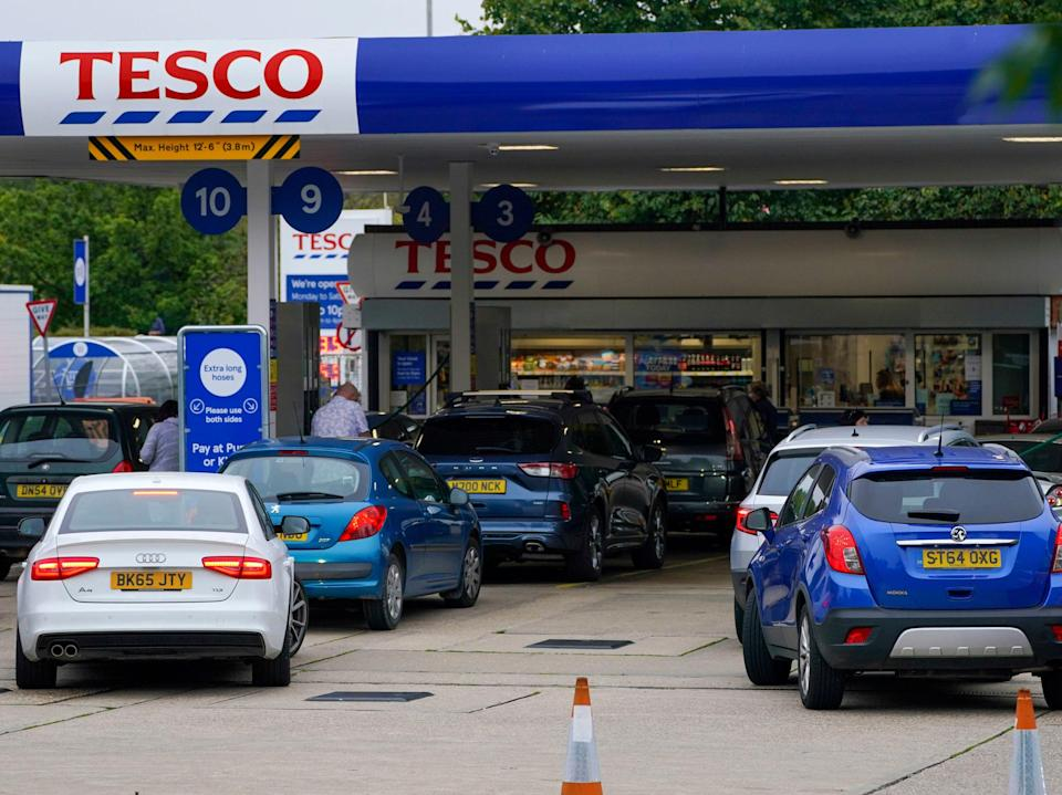 Motorists queue for fuel at a Tesco petrol station in Bracknell (PA)