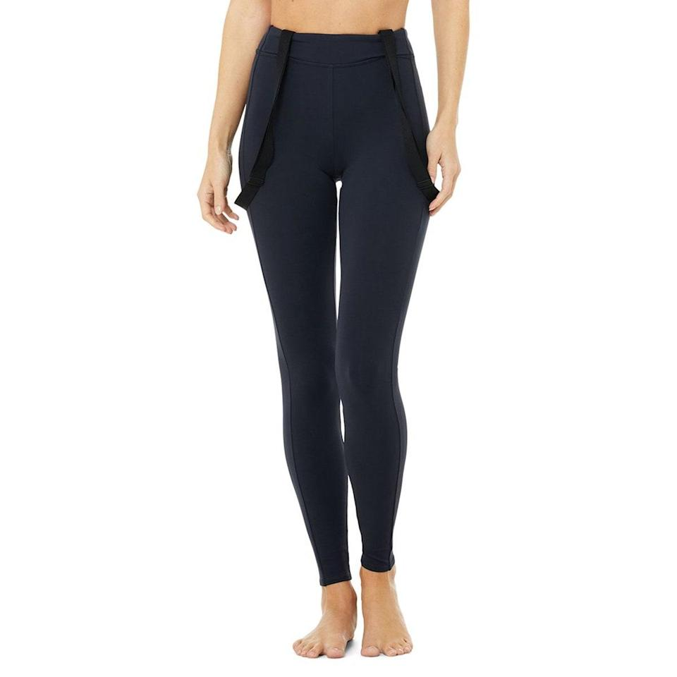 """In love with the great outdoors? The winter adventurer needs these suspender leggings in their life, even if they're skipping sports this year. When you <em>are</em> ready to take the mountaineer-inspired look out of the house, reach for this sleek design that will keep you snug and secure on the slopes or in the studio. $138, Alo. <a href=""""https://www.aloyoga.com/products/w5922r-high-waist-alpine-suspender-legging-dark-navy-black"""" rel=""""nofollow noopener"""" target=""""_blank"""" data-ylk=""""slk:Get it now!"""" class=""""link rapid-noclick-resp"""">Get it now!</a>"""
