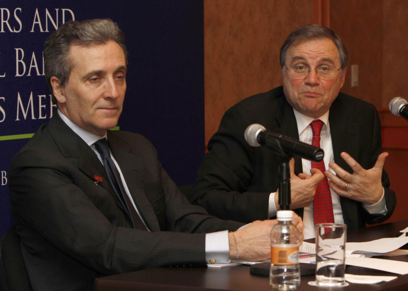 Italy's Deputy Finance Minister Vittorio Grilli, left, and Ignazio Visco governor of the Bank of Italy, right, attend a conference during G-20 Finance Ministers and Central Bank Governors meeting in Mexico City, Sunday Feb. 26, 2012. (AP Photo/Marco Ugarte)