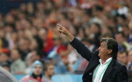FILE PHOTO: Ivory Coast coach Henri Michel gestures during their Group C World Cup 2006 soccer match against Serbia and Montenegro in Munich June 21, 2006. REUTERS/Radu Sigheti/File Photo