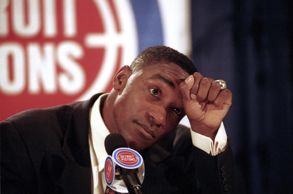 FILE - In this May 11, 1994, file photo, Detroit Pistons guard Isiah Thomas announces his retirement from basketball at the Palace of Auburn Hills, Mich. Thomas' Olympic hopes were denied, not once but twice. Thomas was famously left off the U.S. Olympic team — the first Dream Team — that won a gold medal at the 1992 Barcelona Olympics with ease. But he could have been an Olympian 12 years earlier, had the Americans not boycotted the 1980 Moscow Games. (AP Photo/Richard Sheinwald, File)
