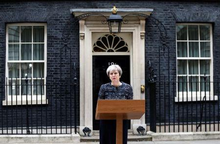 Britain's Prime Minister Theresa May speaks outside 10 Downing Street after traveling to Buckingham Palace to visit Queen Elizabeth after Parliament was dissolved ahead of the general election, in London