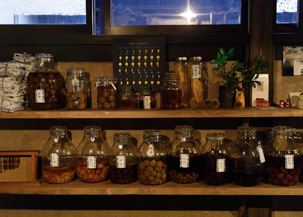 Jars of pickles and homemade liquors line the shelves