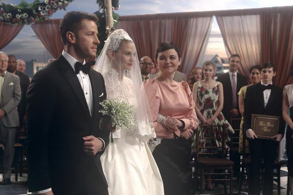 Emma Swan is walked down the aisle by Snow and Charming