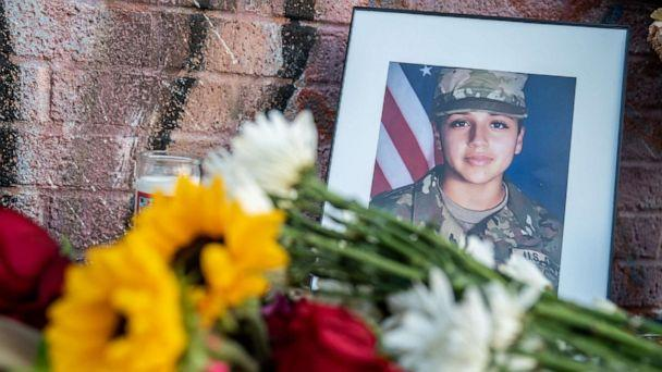 PHOTO: Flowers are laid next to a portrait at a march and vigil in honor of murdered Army Spec. Vanessa Guillen in Austin, Texas, July 12, 2020. (Sergio Flores/Getty Images, FILE)
