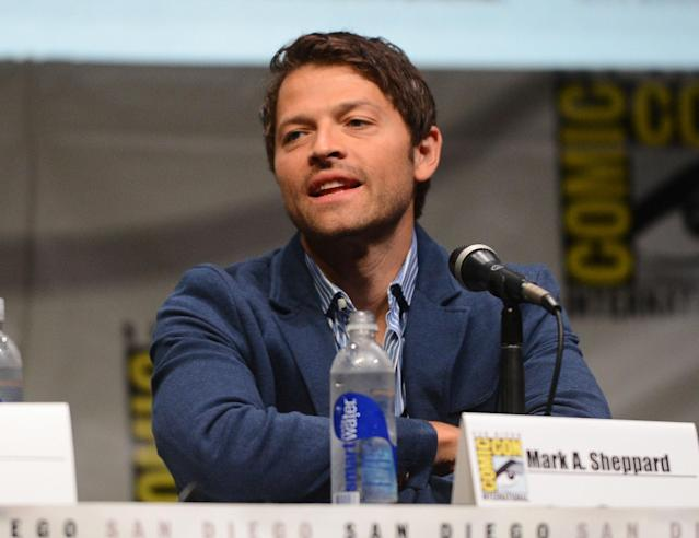 "Misha Collins speaks onstage at the ""Supernatural"" panel during Comic-Con International 2013 at San Diego Convention Center on July 21, 2013 in San Diego, California."