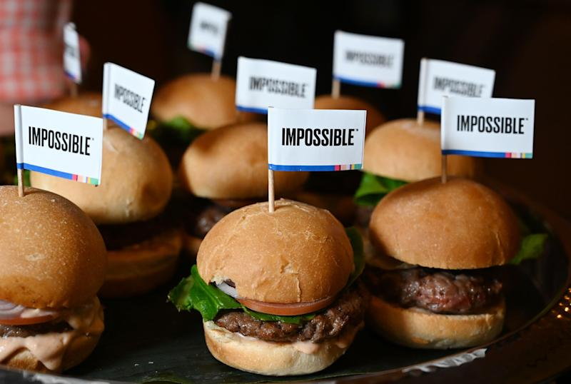 "The Impossible Burger 2.0, the new and improved version of the company's plant-based vegan burger that tastes like real beef is introduced at a press event during CES 2019 in Las Vegas, Nevada on January 7, 2019. - The updated version can be cooked on a grill and has a better flavor and lowered cholesterol, fat and calories than the original. ""Unlike the cow, we get better at making meat every single day,"" CEO of Impossible Foods CEO Pat Brown. (Photo by Robyn Beck / AFP) (Photo by ROBYN BECK/AFP via Getty Images)"