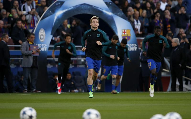 Barcelona's Croatian midfielder Ivan Rakitic warms-up before the UEFA Champions League quarter-final second leg football match FC Barcelona vs Juventus - Credit: GETTY