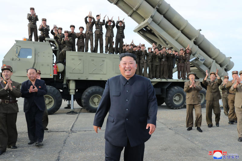 "This Saturday, Aug. 24, 2019, photo provided Sunday, Aug. 25, by the North Korean government, shows North Korean leader Kim Jong Un, center, smiles after the test firing of an unspecified missile at an undisclosed location in North Korea. North Korea fired two suspected short-range ballistic missiles off its east coast on Saturday in the seventh weapons launch in a month, South Korea's military said, a day after it vowed to remain America's biggest threat in protest of U.S.-led sanctions on the country. The content of this image is as provided and cannot be independently verified. Korean language watermark on image as provided by source reads: ""KCNA"" which is the abbreviation for Korean Central News Agency. (Korean Central News Agency/Korea News Service via AP)"