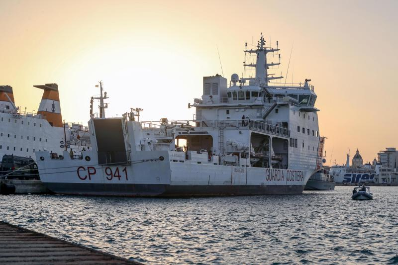 The Diciotti ship of the Italian Coast Guard, with 67 migrants on board rescued 4 days ago by the Vos Thalassa freighter, is moored in the Sicilian port of Trapani, southern Italy, Thursday, July 12, 2018. An Italian coast guard ship has docked in Sicily but is still awaiting permission to disembark its 67 migrants, after two of them were accused of threatening their rescuers if they were taken back to Libya. Interior Minister Matteo Salvini said Thursday he won't let the migrants off until there is clarity over what happened after an Italian commercial tugboat rescued them over the weekend. Italy's transport minister said some migrants made death threats against the crew. The threats prompted the Italian coast guard to board the migrants and bring them to Trapani. (Igor Petyx/ANSA via AP)