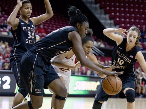 Florida State's Natasha Howard, front left, and Maryland's Tianna Hawkins (21) scramble for the ball during the second half of an NCAA college basketball game Sunday, Jan. 6, 2013, in College Park, Md. (AP Photo/Jose Luis Magana)