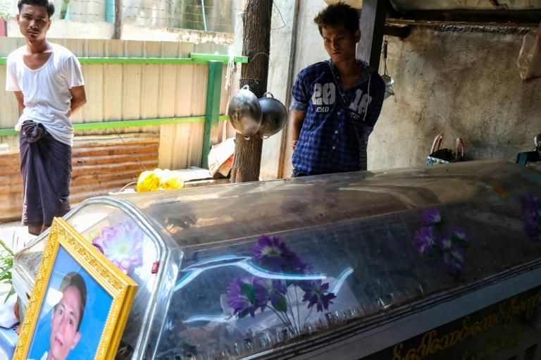 The coffin of a teashop owner shot dead during protests in Mandalay