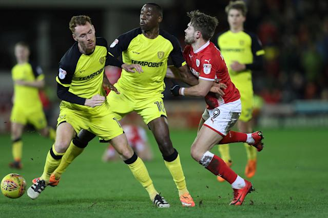 "Soccer Football - Championship - Barnsley vs Burton Albion - Oakwell, Barnsley, Britain - February 20, 2018 Barnsley's Tom Bradshaw in action with Burton Albion's Lucas Akins and Tom Naylor Action Images/John Clifton EDITORIAL USE ONLY. No use with unauthorized audio, video, data, fixture lists, club/league logos or ""live"" services. Online in-match use limited to 75 images, no video emulation. No use in betting, games or single club/league/player publications. Please contact your account representative for further details."