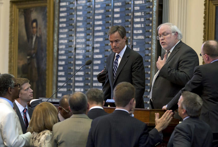 Speaker of the House Joe Straus, R-San Antonio, left, and parliamentarian, Chris Griesel, right, deal with a point of order by Democrats on the House floor of the State Capitol in Austin, Texas, on Sunday, June 23, 2013. (AP Photo/Statesman.com, Rodolfo Gonzalez)